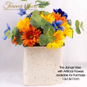 A rainbow of silk gerberas in this amazing bouquet with a handmade ceramic speckled vase