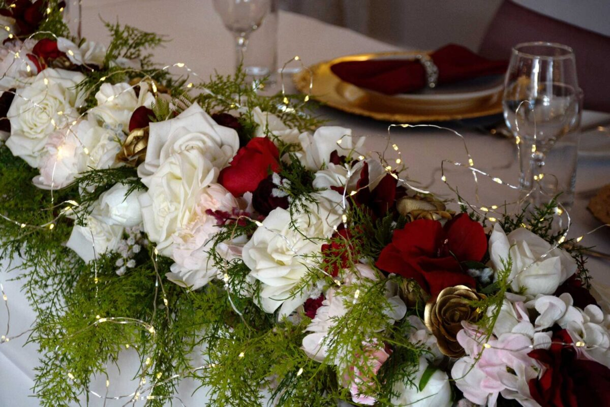 Table runner, artificial flowers, roses, fairy lights